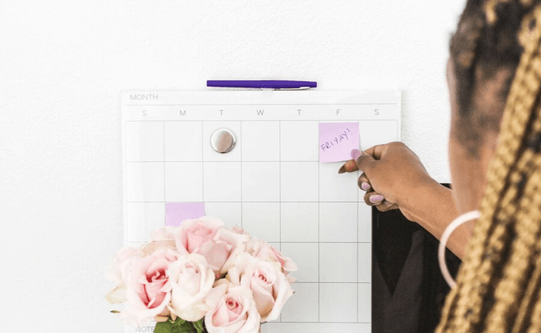 pink roses and a calendar with sticky notes