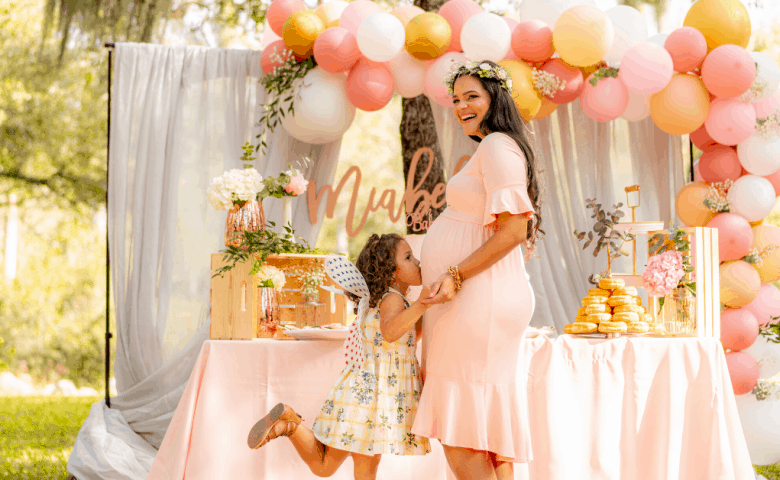 mother surrounded by pink balloons, daughter and love