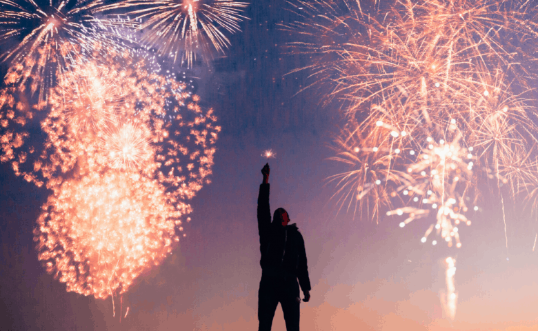 4th of July fireworks and a guy celebrating