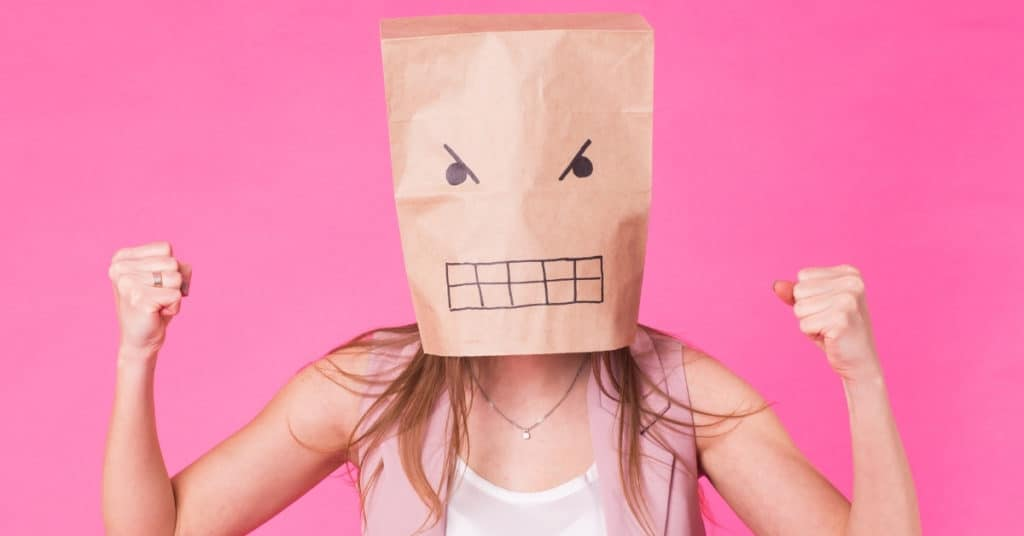 Angry woman with a paper bag on his face